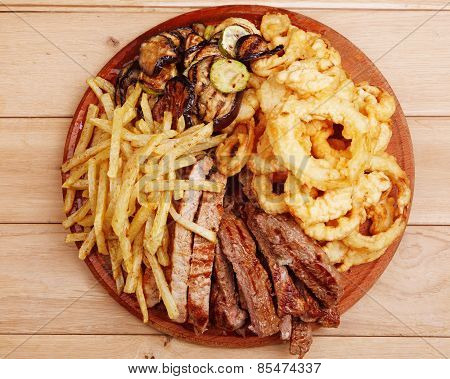 Wholesome Platter Of Mixed Meats Including Grilled Steak, Crispy Crumbed Chicken And Beef