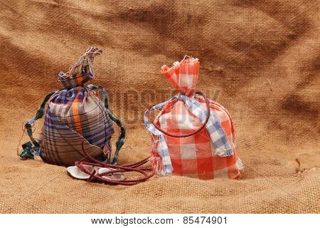 Two Bags And Buttons On A Background Of Burlap