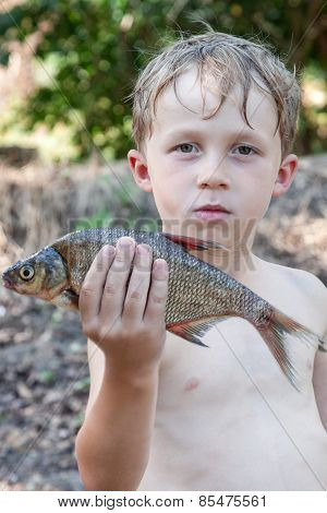 Boy Holding A Dead Fish