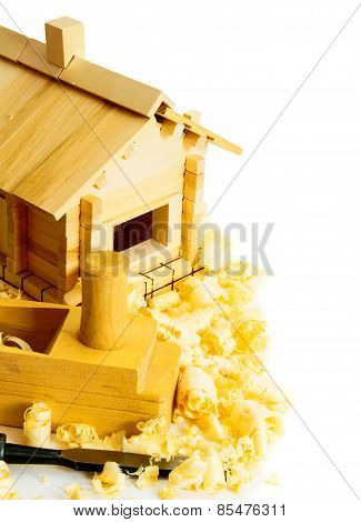 House construction. Joiner's works. The wooden house, chisel, plane and shaving on white background.