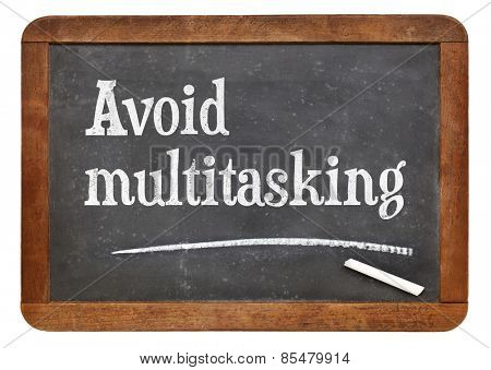 Avoid multitasking advice  on a vintage slate blackboard