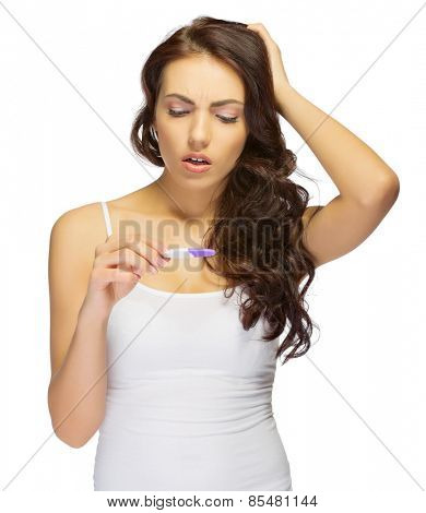 Young displeased girl with pregnancy test isolated