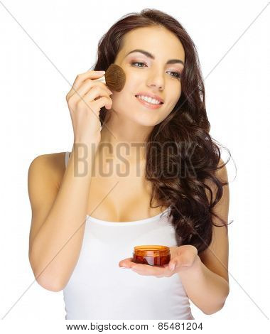 Young girl with makeup brush isolated