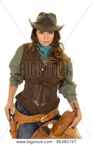 Cowgirl Holding Saddle Hand On Gun