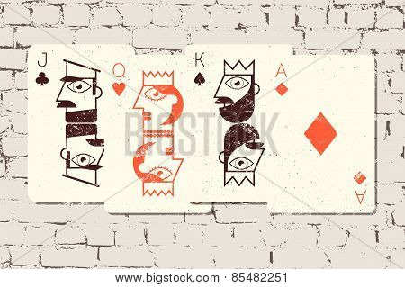 Jack, Queen, King and Ace. Stylized playing cards in grunge style on the brick wall background. Vect