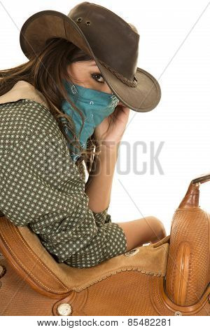 Cowgirl With Bandana On Face Lean On Saddle