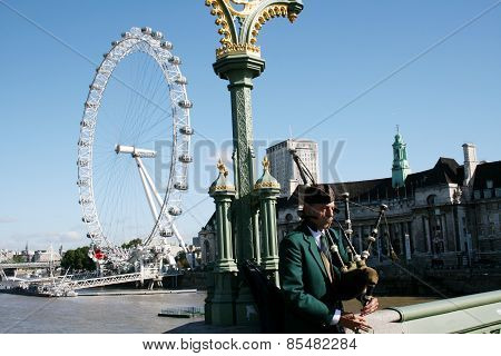 Bagpipe player on Westminster Bridge