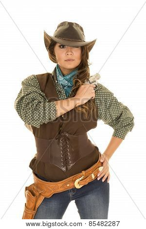 Cowgirl With Gun And Holster Arm At Shoulder