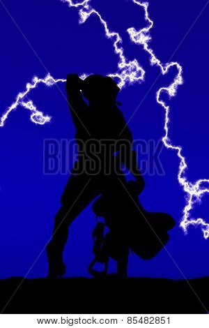 Silhouette Of Cowgirl Holding Saddle Arm Behind Head