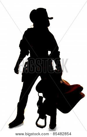 Silhouette Of Cowgirl Holding Saddle Arm Out