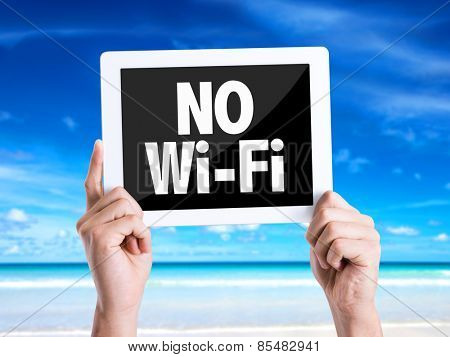 Tablet pc with text No Wi-Fi with beach background