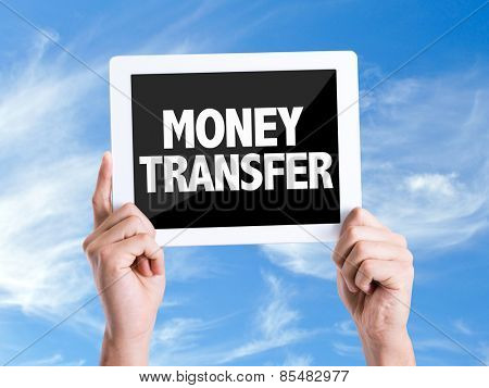 Tablet pc with text Money Transfer with sky background