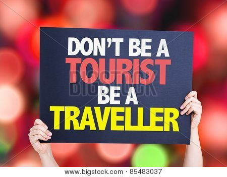 Don't be a Tourist Be a Traveller card with bokeh background
