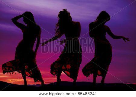 Silhouette Of Three Women In Bikinis And Sarong Dancing