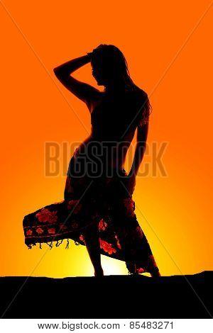 Silhouette Of Woman In Bikini And Sarong Blowing
