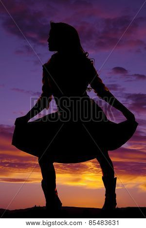 Silhouette Of Woman Playing With Her Skirt Look Side