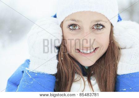 A woman portrait outside in winter season