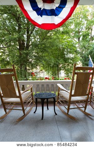 Chairs And Table At The Terrace With American Flag