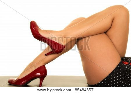 Woman Legs With Red Heels Crossed