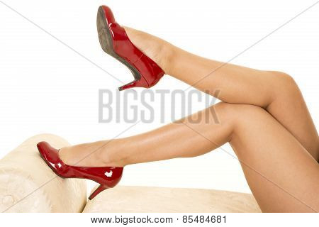 Woman Legs With Red Heels One Foot On Couch