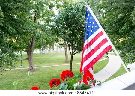 American Flag Flying From A Balcony Or Patio