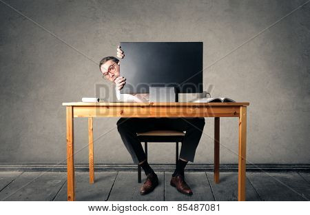 Sitting at his desk