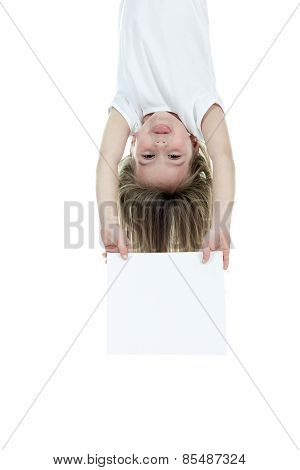 children girl holding a white card over a white background.