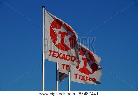 Texaco flags  blowing in the wind