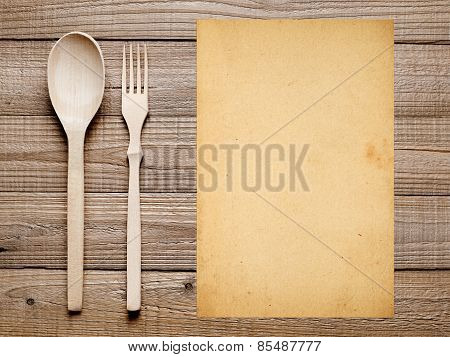 Blank Paper, Fork And Spoon On Wooden Table