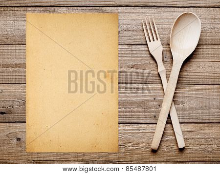 Old Paper For Menu Or Recipe Background. Fork And Spoon On Wooden Table.