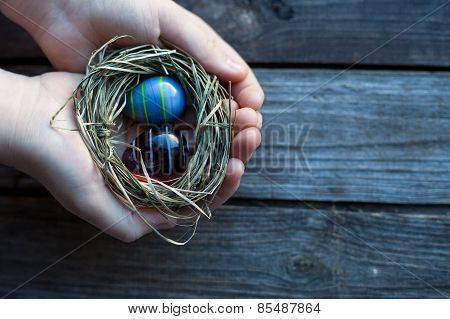 Easter Decoration - Glass Eggs In Hands