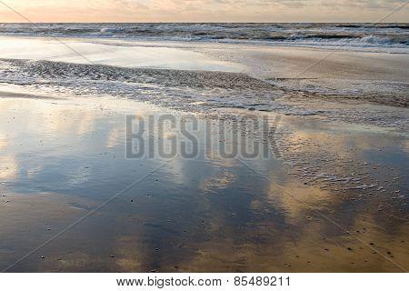 Reflection Of The Sun On The Beach.