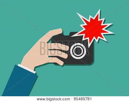 hand with photo camera and flash icon design