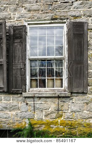 Historic Stone House Window with Clay Jugs.