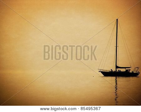 sailboat silhouette in sunset haze