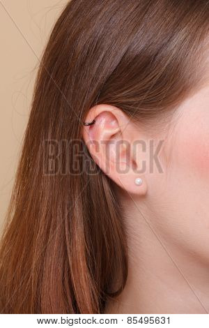 Closeup Human Ear With Earrings
