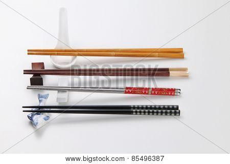 Pair of chopsticks on white background