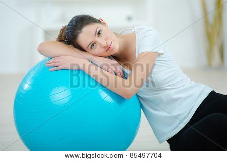 Woman using an inflatable gym ball