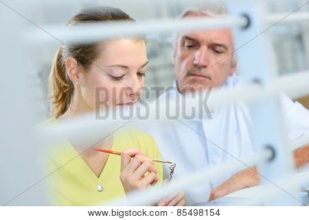 Busy dentist with a patient