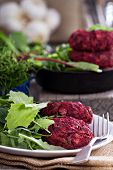 stock photo of veggie burger  - Beet root and red bean vegan burgers with salad - JPG