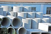 foto of septic  - Concrete circle pit and pipe block on factory yard - JPG
