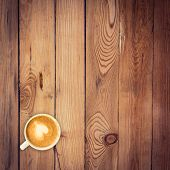 picture of latte  - Top view latte coffee on wood table with space - JPG