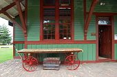 image of caboose  - A 20th century train depot with an old chest and a cart - JPG