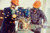 foto of welding  - Worker welding in industrial background at factory - JPG