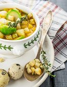 stock photo of brussels sprouts  - Homemade soup with brussels sprouts and croutons in white bowl decorated with a sprig of thyme - JPG
