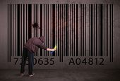 stock photo of barcode  - Young urban painter drawing a barcode on the wall - JPG