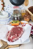 foto of porterhouse steak  - Raw steaks on the kitchen table ready to cook  - JPG