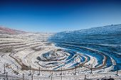 stock photo of open-pit mine  - iron ore open pit mining quarry winter - JPG