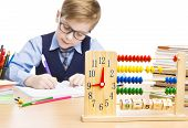 stock photo of pupils  - School Child Pupil Education Clock Abacus Students Boy in Glasses Counting Math Lesson Kid Writing Exercise Book over White Background - JPG