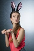 picture of earings  - Beautiful natural gorgeous blonde woman with funny fluffy rabbit ears on the head - JPG